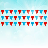 Party flags on sunny background Stock Photos