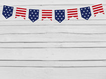 Party flags on wooden background. 4th July, Independence day, card, invitation in usa flag colors. Top view, empty space. Stock Photography