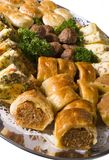 Party Food. Platter of hot party pies, sausage rolls, quiche and savoury meatballs on a silver catering platter stock photos