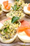 Party food. Stuffed eggs and smoked salmon on a party plate Royalty Free Stock Photos