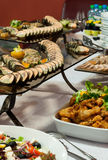 Party food, catering. Luxurious platters of catering food assortment, cold cuts Stock Image