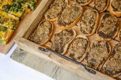 Party food: Italian black truffle bruschetta - close up. Bruschetta with black truffle in a rustic wooden tray royalty free stock photos