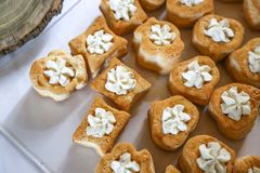 Party food: puff pastry vol-au-vents. Filled with mushroom ragout, topped with fresh parsley royalty free stock photo