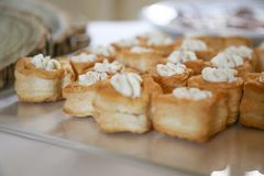 Party food: puff pastry vol-au-vents. Filled with mushroom ragout, topped with fresh parsley stock image