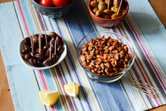 Party food. With pumpkin seeds, olives and lemon royalty free stock images