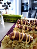 Party food. Sausages with sauerkraut on bread  for party Royalty Free Stock Photography