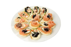 Party food selection. Canapés with fish and seafood Royalty Free Stock Photos