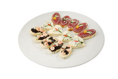 Party food selection. Canapé selection on white plate isolated Royalty Free Stock Image
