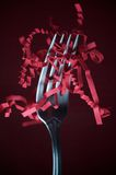 Party Fork. A dinner fork stabbing a handful of confetti Stock Photography