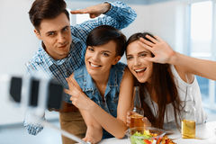 Party. Friends Making Selfie Portrait Photo Using Smartphone. Fr. Party. Group Of Happy Friends Making Self Portrait Photo Using Smartphone Selfie Stick royalty free stock image