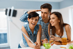 Party. Friends Making Selfie Portrait Photo Using Smartphone. Fr. Party. Group Of Happy Friends Making Self Portrait Photo Using Smartphone Selfie Stick royalty free stock photography