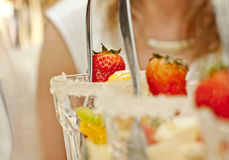 Party fruit. Red strawberries and other fruit in glasses on the party table Stock Image