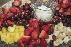 Party fruit platter background. A beautiful party fruit platter beckons for tasting delicious fresh fruit Stock Images
