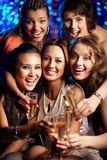 Party in full swing. Vertical shot of girls having fun at nightclub holding a bridal party Royalty Free Stock Photos