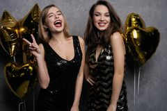 Party Fun. Beautiful Girls Celebrating New Year. Portrait Of Gorgeous Smiling Young Women Enjoying Party Celebration. Having Fun Together stock photography