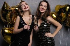 Party Fun. Beautiful Girls Celebrating New Year. Portrait Of Gorgeous Smiling Young Women Enjoying Party Celebration. Having Fun Together stock image