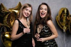 Party Fun. Beautiful Girls Celebrating New Year. Portrait Of Gorgeous Smiling Young Women Enjoying Party Celebration. Having Fun Together royalty free stock photo