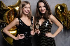 Party Fun. Beautiful Girls Celebrating New Year. Portrait Of Gorgeous Smiling Young Women Enjoying Party Celebration stock images