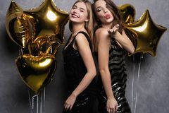 Party Fun. Beautiful Girls Celebrating New Year. Portrait Of Gorgeous Smiling Young Women Enjoying Party Celebration stock photography