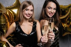 Party Fun. Beautiful Girls Celebrating New Year. Portrait Of Gorgeous Smiling Young Women Enjoying Party Celebration royalty free stock photo