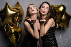 Party Fun. Beautiful Girls Celebrating New Year. Portrait Of Gorgeous Smiling Young Women Enjoying Party Celebration royalty free stock image