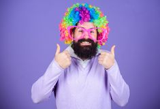 Party fun. Enjoy being crazy. Feel free to express yourself. Having fun. Holiday fun and carnival concept. Man bearded. Wear colorful wig and funny glasses on royalty free stock photos