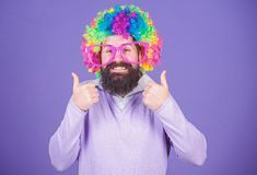Party fun. Enjoy being crazy. Feel free to express yourself. Having fun. Holiday fun and carnival concept. Man bearded. Wear colorful wig and funny glasses on stock photography