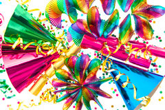 Party garlands, streamer, cracker, hats, confetti. Colorful party decoration garlands, streamer, cracker, hats and confetti. festive background Royalty Free Stock Images