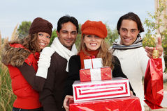 Party gifts. Group of party goers with gifts royalty free stock photos