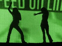 Party girl. Silhouette of party girl over green beam Royalty Free Stock Image