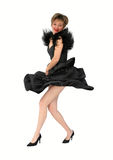 Party girl. Girl in black dress dancing Royalty Free Stock Photos