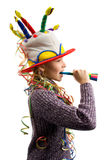 Party girl. Birthday girl with streamers and horn stock image
