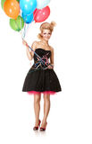 Party girl with balloons. Blond girl with balloons standing over white background royalty free stock image