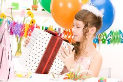 Party girl with balloons and gift box Royalty Free Stock Images