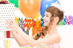 Party girl with balloons and gift box Stock Image