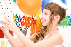 Party girl with balloons and gift box Royalty Free Stock Photo