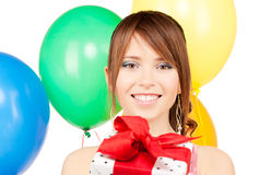 Party girl with balloons and gift box Royalty Free Stock Image