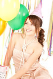 Party girl with balloons and gift box Royalty Free Stock Photography