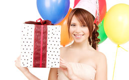 Party girl with balloons and gift box Stock Images