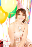 Party girl with balloons and gift box Royalty Free Stock Photos