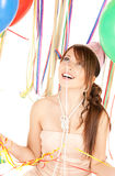 Party girl with balloons Stock Images