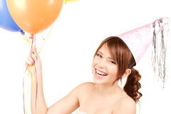 Party girl with balloons. Happy teenage party girl with balloons over white stock photos