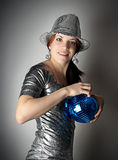 Party girl with blue disco ball Royalty Free Stock Photos