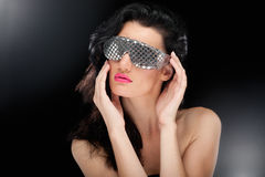 Party girl in club glasses Stock Photo