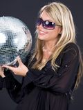 Party girl with disco ball Stock Photos