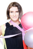 Party Girl Draped In Party Balloons And Streamers Royalty Free Stock Photo