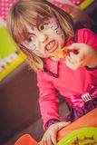Party girl eating party food Royalty Free Stock Images