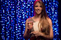 Party girl with a glass of champagne stock photography