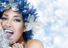 Party Girl. Holiday Makeup and Hairstyle. Happiness. Party girl. Beautiful Christmas woman. Professional holiday makeup and fancy hairstyle. Fashion woman Royalty Free Stock Photo