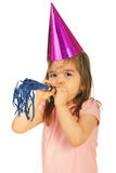 Party girl with noise maker Royalty Free Stock Images